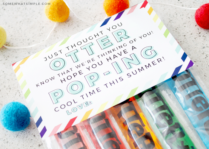 5 otter pops laying on the counter with a gift tag laying on top