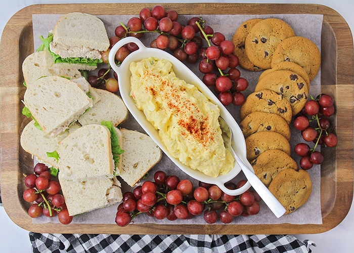 Picnics are a fun way to celebrate the summer with family and friends. These simple tips and tricks make it easy to throw the perfect picnic!
