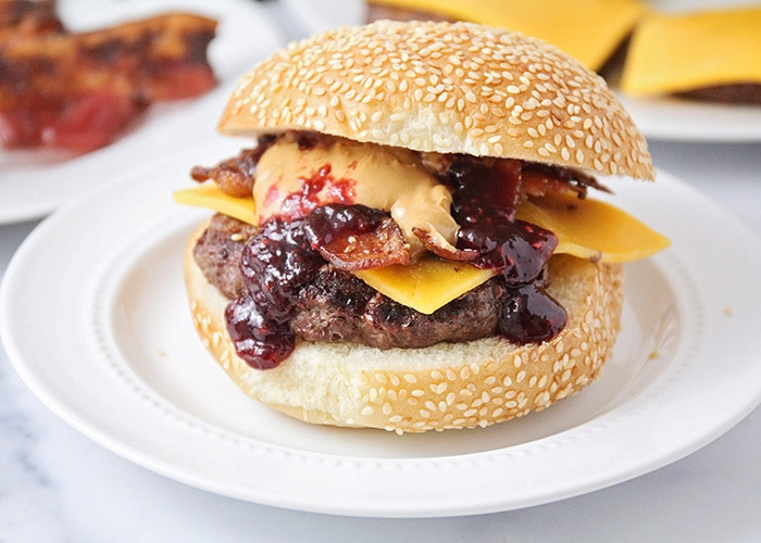 These peanut butter and jelly bacon cheeseburgers are over-the-top delicious, and so easy to make! They're a fun twist on a basic burger!