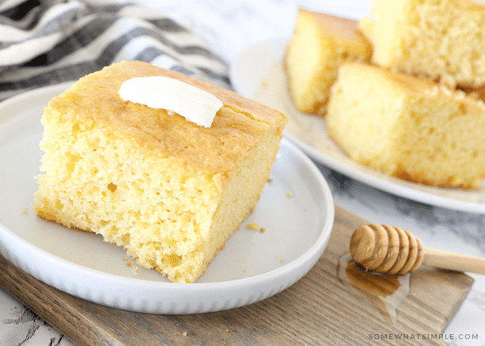 squares of cornbread topped with a pad of butter