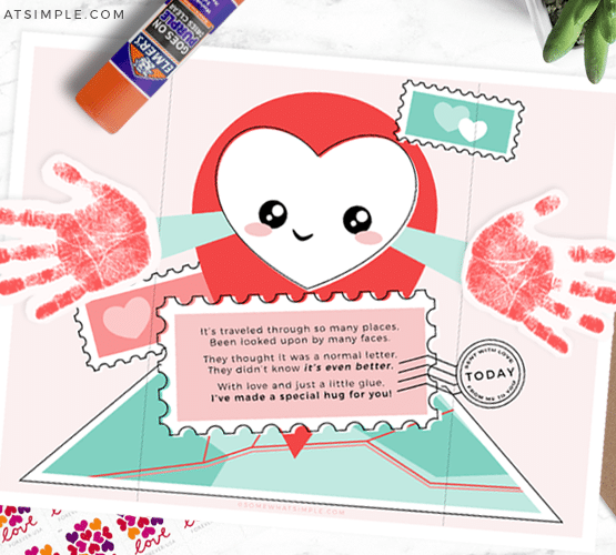 hug in the mail card idea printed and laying on the counter