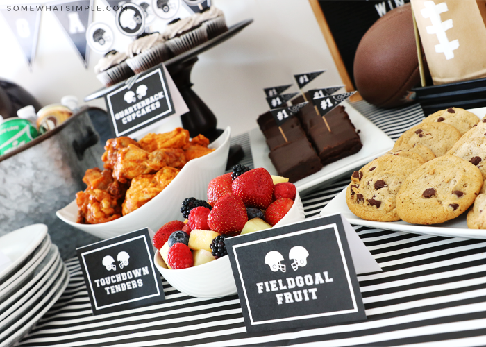 tailgating food on a table with food labels