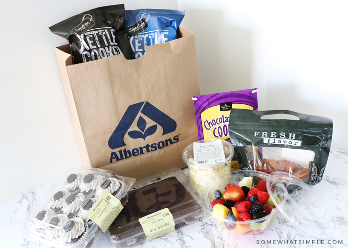 food for a tailgating party in an albertsons grocery bag