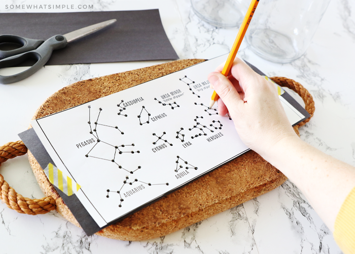 poking constellation paper with a pencil