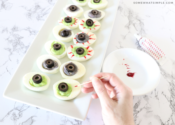 making halloween deviled eggs using food coloring
