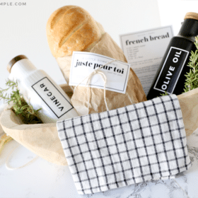 gift basket with bread, olive oil and vinegar bottles