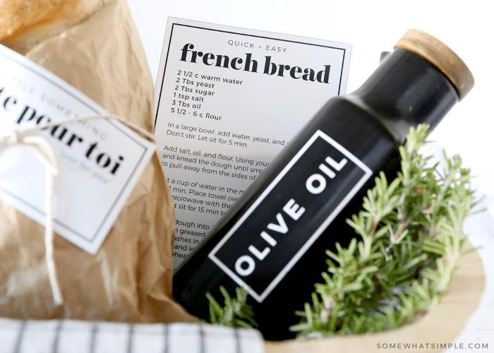 olive oil bottle in a basket with french bread