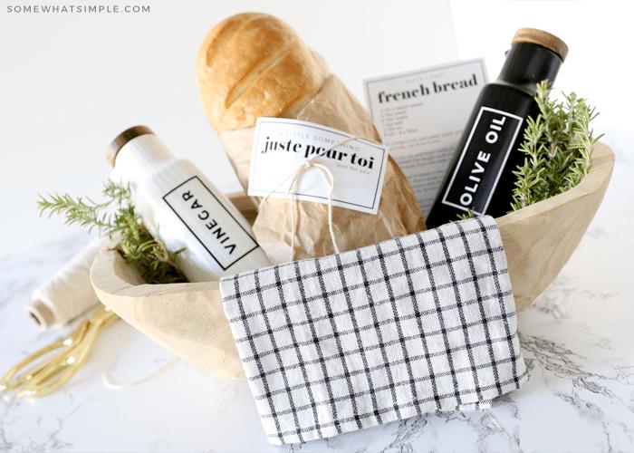 gift basket with bread, olive oil and vinegar bottles