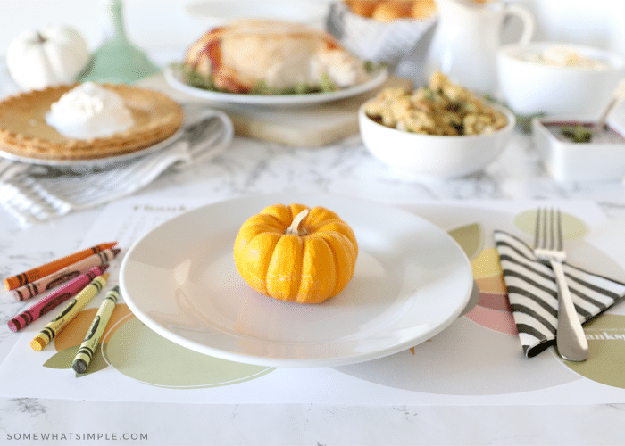 simple thanksgiving place setting with printable placemat and food in the background