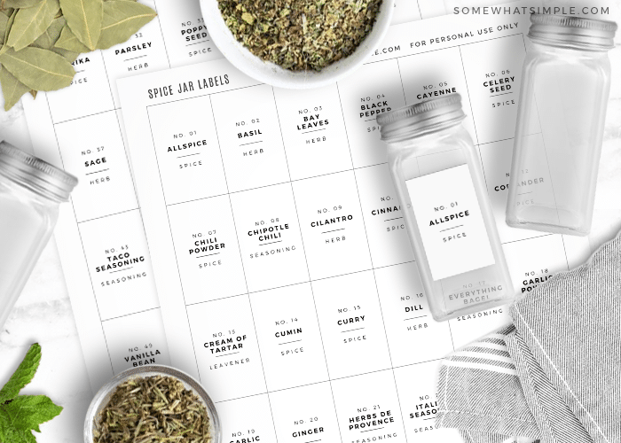 printable spice jar labels next to some glass spice jars