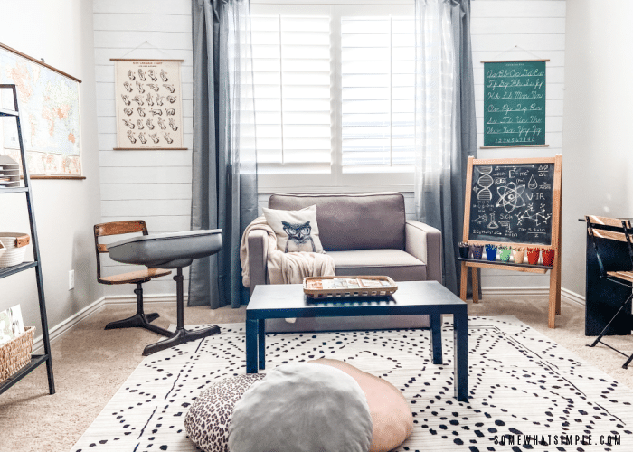 front view of a home classroom with a couch and a rug