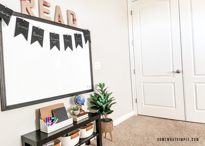 front view of a homeschool room with a white board and bookshelf