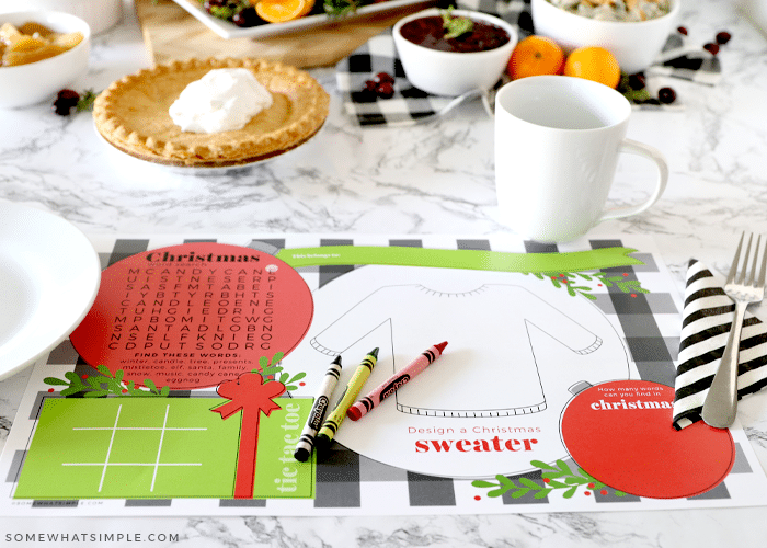 printable christmas placemats on the counter with food in the background