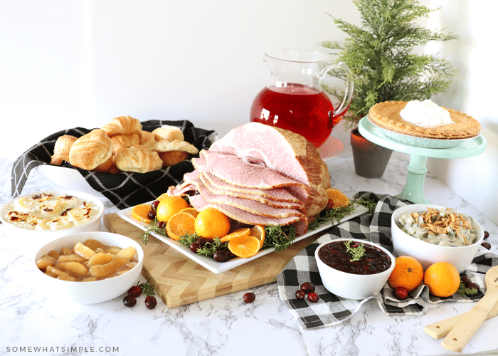 christmas dinner with ham and vegetables served on the counter