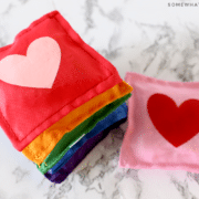 stack of rainbow bean bags with hearts in the center