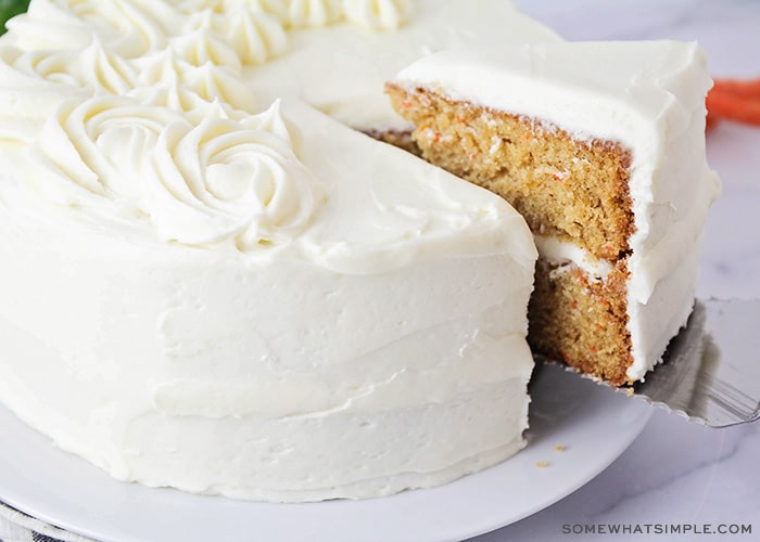 a slice cut out of a carrot cake