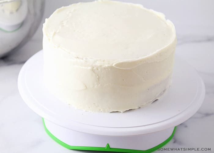 a carrot cake covered in white icing