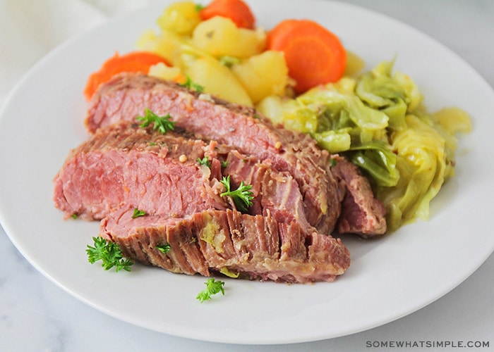 a plate of corned beef and cabbage