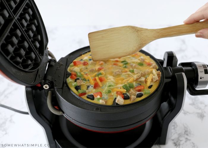 omelet being cooked in a waffle iron
