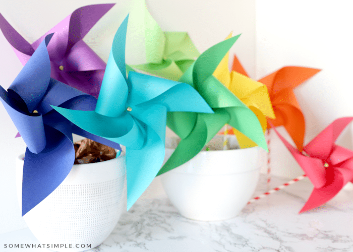 colorful paper pinwheels in bowls on the counter