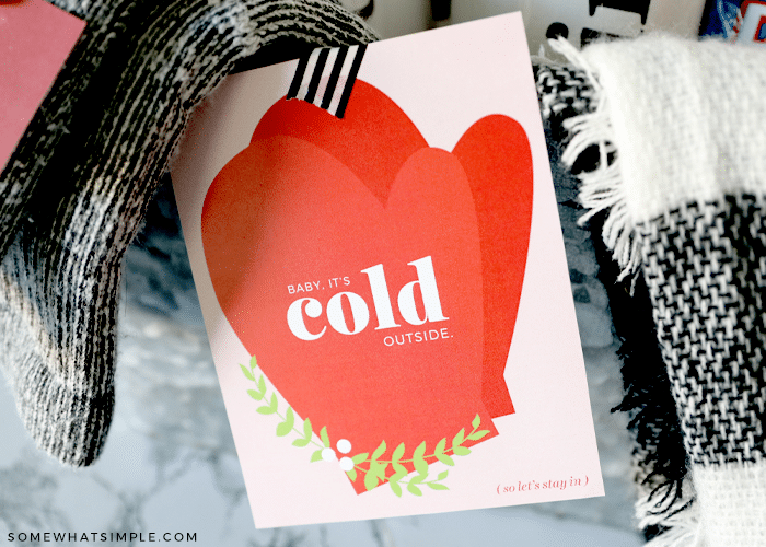 baby its cold outside gift tag on a date night basket