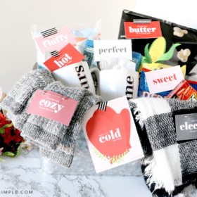 a date night basket with various items for a cozy indoor date - blankets, snacks, hot cocoa, etc.