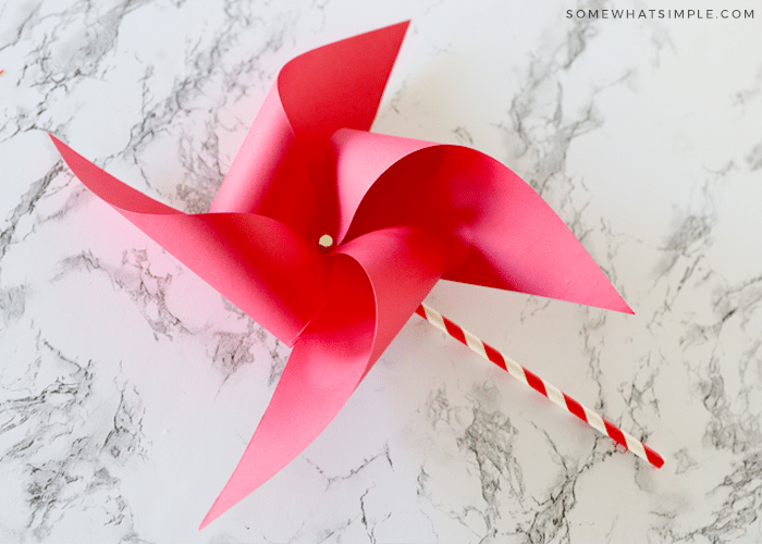 finished paper pinwheel with red paper on the counter