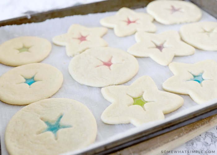 thick stained glass cookies on a baking sheet
