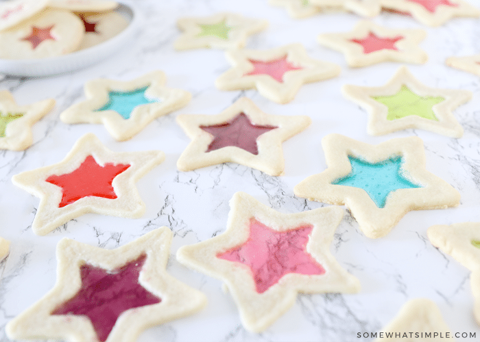 stained glass cookies in a variety of colors on the counter