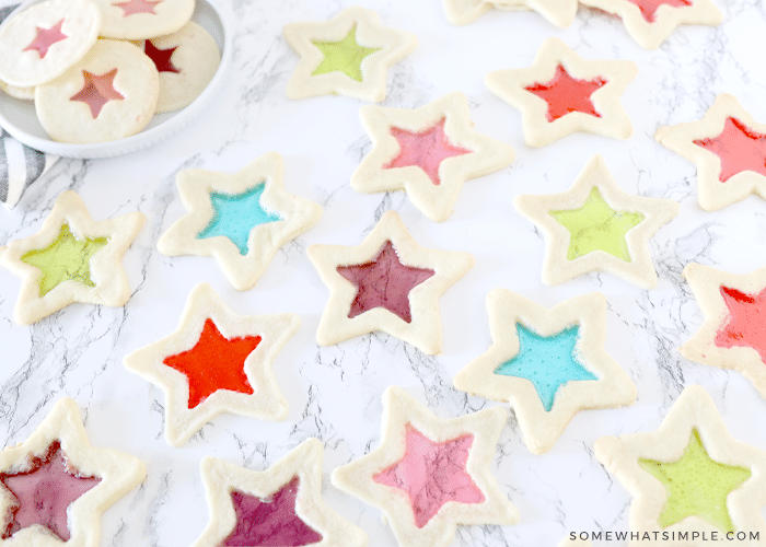 star stained glass cookies on a white counter