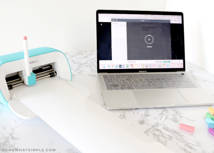 laptop with cricut joy on a white counter