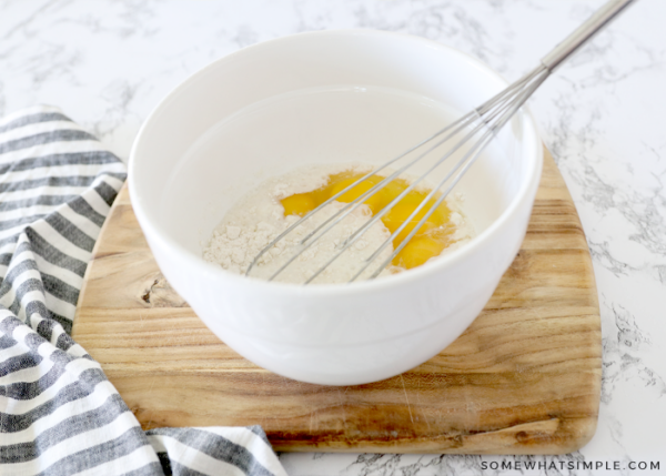 bisquick in a bowl with eggs
