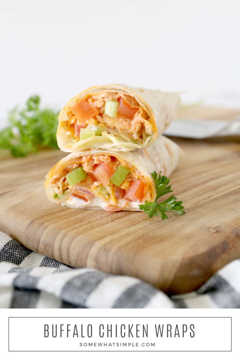 stacked buffalo chicken wraps on a cutting board