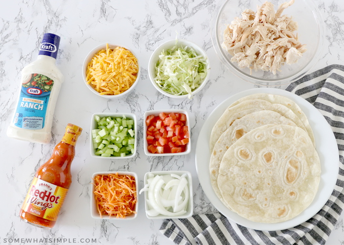 ingredients for chicken wraps on the counter