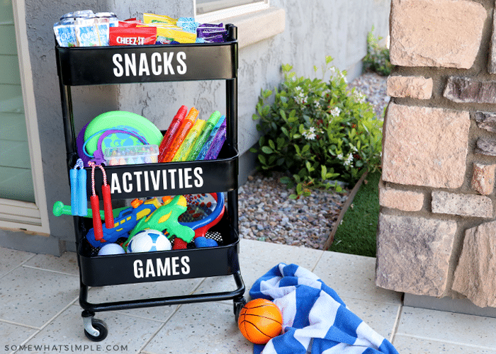 black cart with games and snacks for kids to play outside