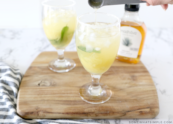 adding all other ingredients to a pineapple margarita