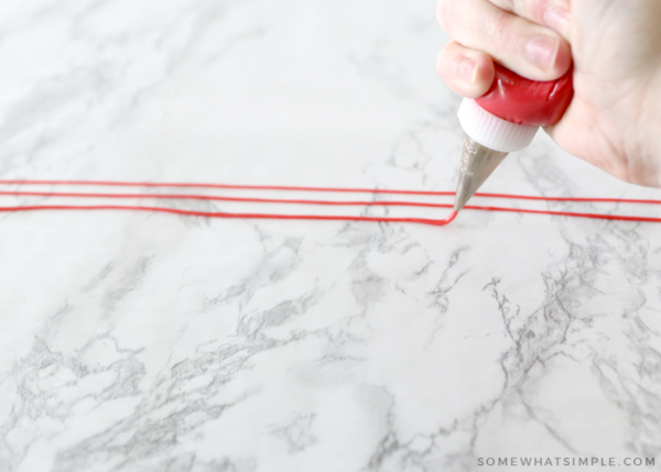 piping lines on wax paper to make sprinkles