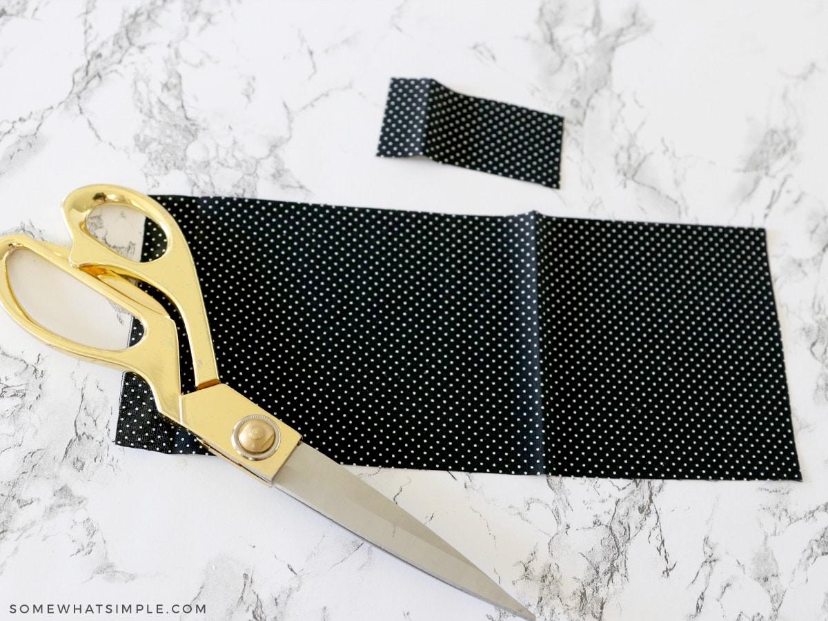 cutting fabric to make a hair bow