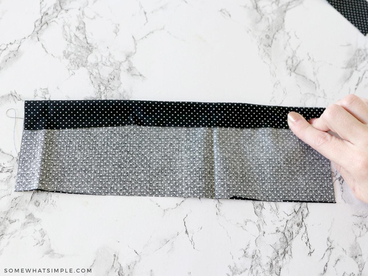 folding fabric to make a bow