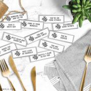 food pun utensil tags next to gold silverware