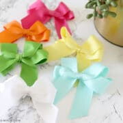 6 colors of hair bows laying on the counter