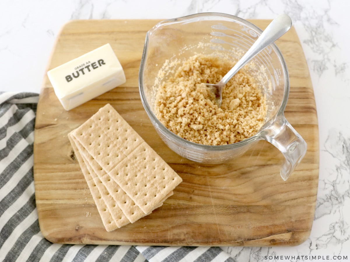 mixing graham crackers and melted butter