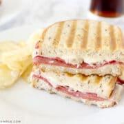 reuben sandwich on a white plate