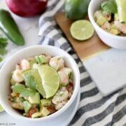 white bowl with shrimp avocado salad