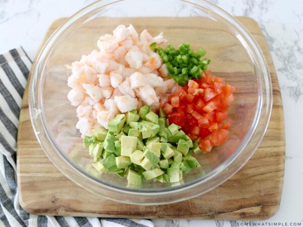 large bowl with shrimp, tomato, avocado and jalapeno