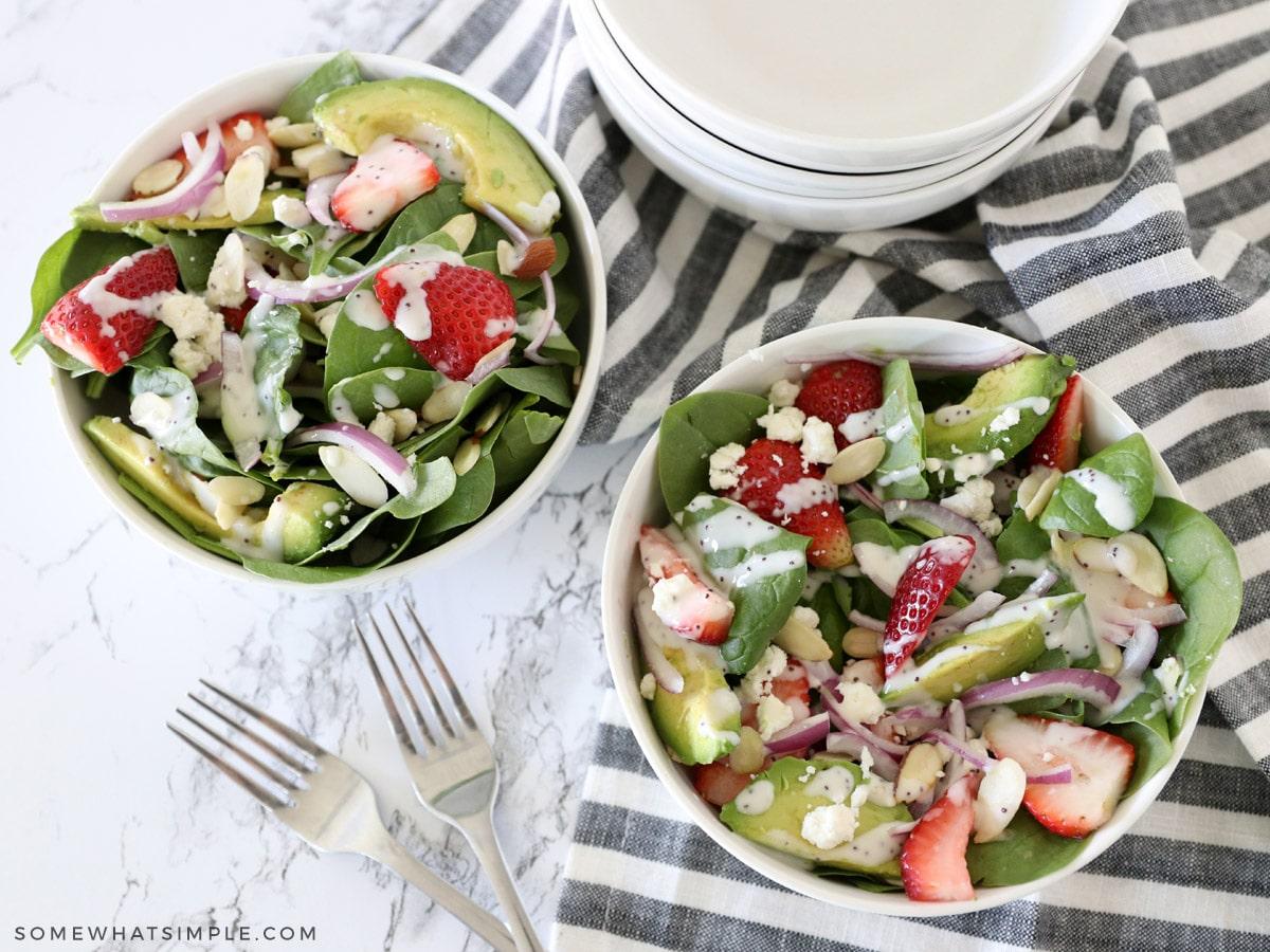 overhead shot of a strawberry spinach avocado salad