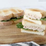 tuna salad sandwich cut in half and stacked on top of each other