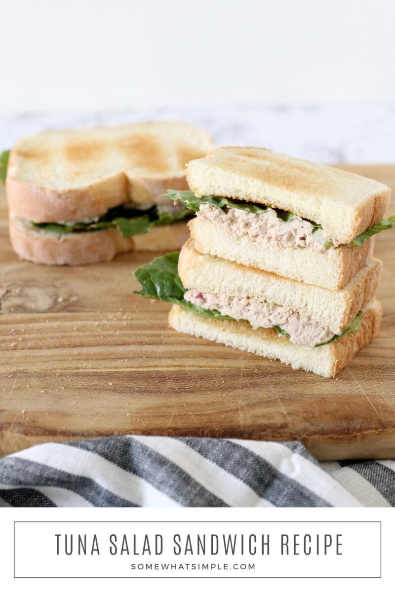 tuna salad sandwich on a wood cutting board