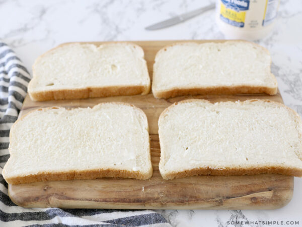 spreading mayo on slices of bread