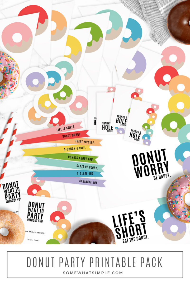 huge pack of donut party printables on a white counter top